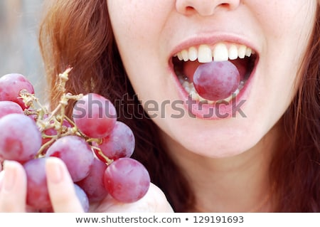 mouth of woman eating grapes Stock photo © photography33