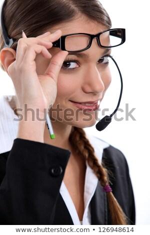 Telephonist raising her glasses Stock photo © photography33