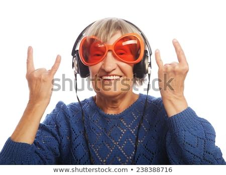 Aantrekkelijk oude dame hoofdtelefoon luisteren muziek Stockfoto © stockyimages