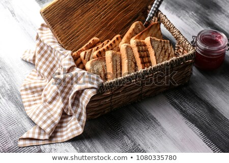 bread with slices in basket stock photo © ozaiachin