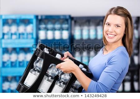 Kobieta skrzynia plastikowe butelek metal Zdjęcia stock © photography33
