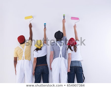 Man with paint brush raising arm Stock photo © photography33