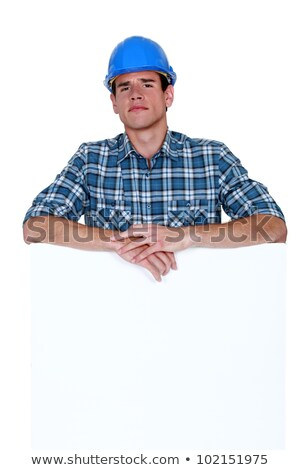 Skeptical workman with a blank board Stock photo © photography33
