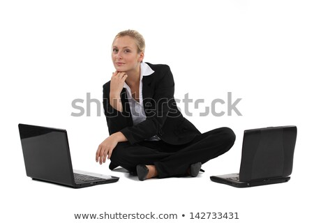 blond businesswoman sat on the floor with two laptops stock photo © photography33