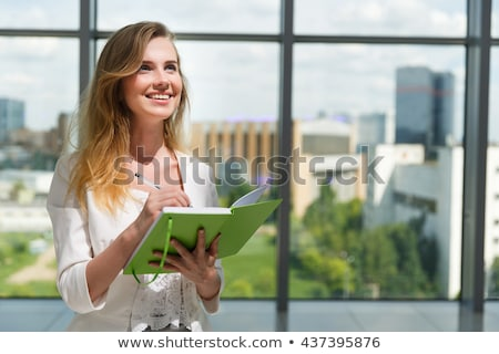 blond businesswoman holding diary stock photo © photography33