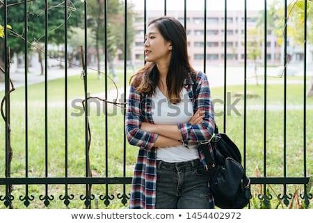 Stylish woman waiting to cross the street Stock photo © photography33