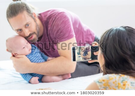 Adorable cheerful wife embracing her husband Stock photo © stockyimages