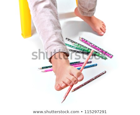Child's feet  performing gymnastic with pencils Stock photo © g215