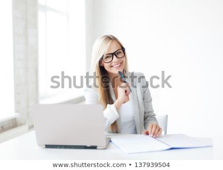 Atractivo mujer de negocios estudiar papeleo sonriendo aislado Foto stock © Len44ik