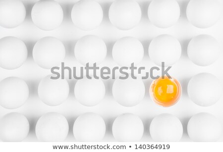 Box of eggs. One cracked. Stock photo © snyfer