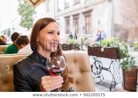 Vrouw brunette patio wijnglas mooie vrouw Stockfoto © saje