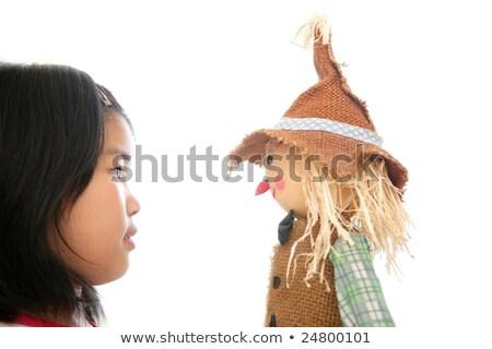 asiático · menina · olhando · espantalho · brinquedo · isolado - foto stock © lunamarina