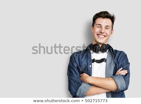 słuchanie · muzyki · śpiewu · słuchawki · młody · człowiek · muzyki - zdjęcia stock © artush