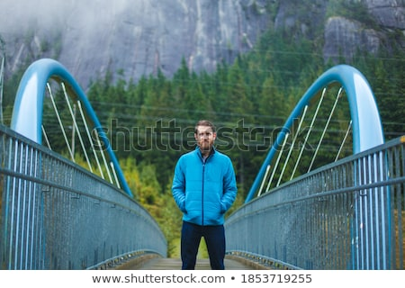 casual man in the mountains with hand in pocket Stock photo © feedough