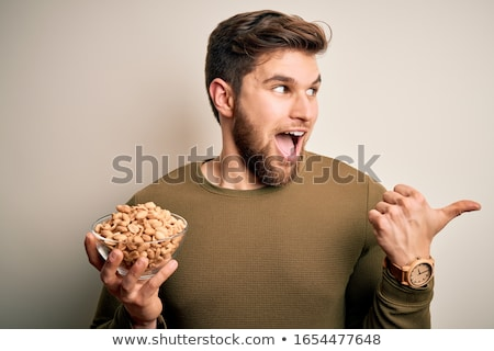eating a peanut stock photo © hofmeester