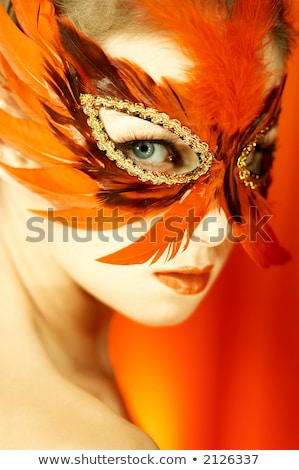 Stock photo: Portrait of blonde young girl in carnival mask.
