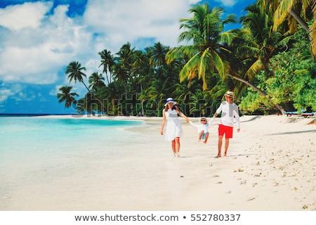 young boy enjoys the tropical beach and the ocean Stock photo © meinzahn