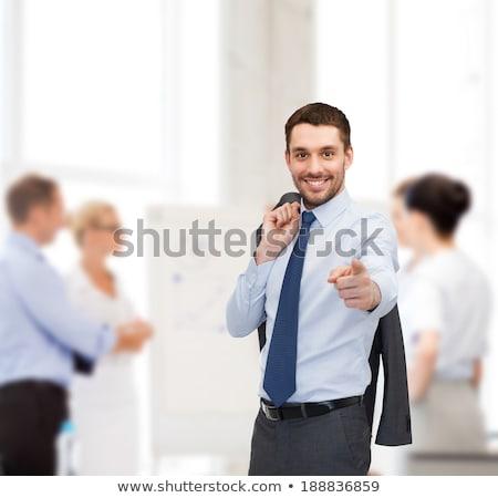 handsome buisnessman pointing finger at you stock photo © dolgachov