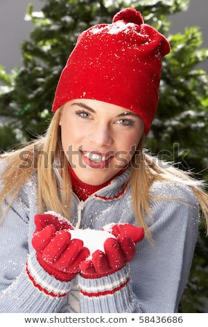 Fashionable Woman Wearing Cap And Knitwear Holding Snowball In S Stock photo © monkey_business