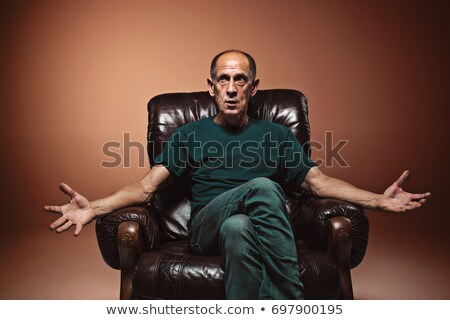 Mature man expressing negative emotions  Stock photo © tab62