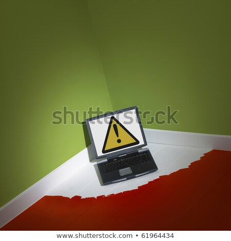 laptop computer painted with hazard warning on screen Stock photo © ozaiachin