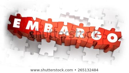 embargo   word on red puzzles stock photo © tashatuvango