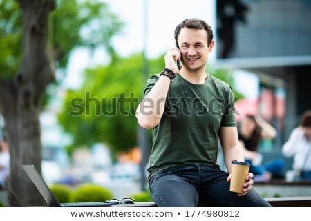 casual businessman talking on phone on park bench stock photo © wavebreak_media