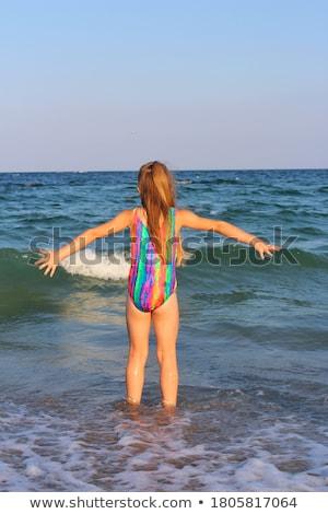 Happy blonde in the sea leaping in bikini Stock photo © wavebreak_media
