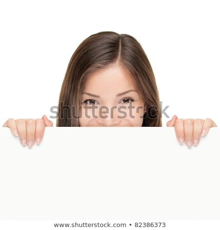 happy woman peeping over white board stock photo © deandrobot