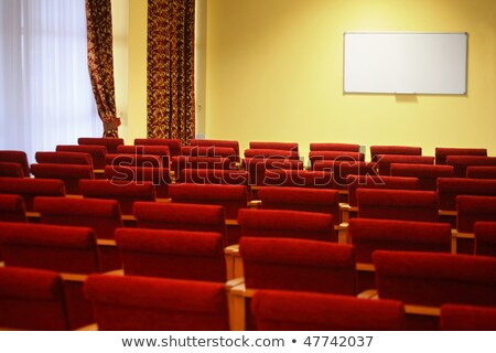 Overlook of empty conference hall. rows of a chairs. window in a left side of image. focus on a scre Stock photo © Paha_L