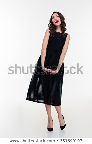 Joyful inspired retro styled woman in black dress and  shoes  Stock photo © deandrobot