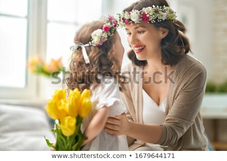 portrait of beautiful happy young woman in flower wreath stock photo © deandrobot