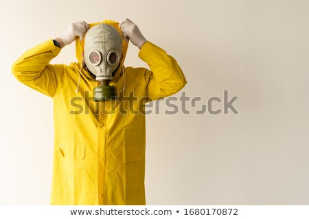 Hooded man taking off his face mask Stock photo © stevanovicigor
