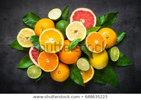 Sliced citrus fruit on natural slate stone background Stock photo © tab62