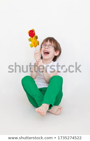 Boy holding a sweet yummy Christmas candy Stock photo © lovleah