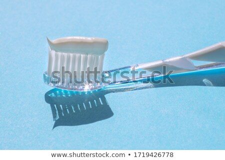 toothbrush with toothpaste close-up  Stock photo © OleksandrO