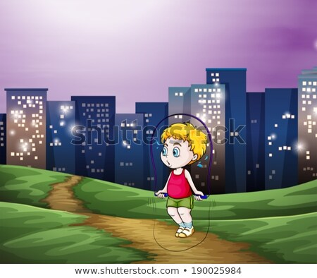A young boy playing across the tall buildings in the city Stock photo © bluering