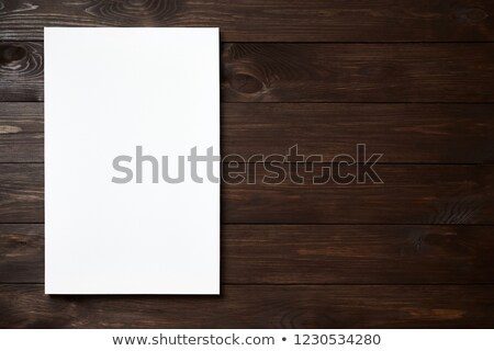 Blank Art Canvas on Wood Planking in Front of Wall Stock photo © frannyanne
