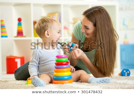 Parents play with baby on carpet Stock photo © IS2