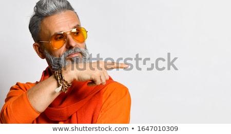 улыбаясь · бизнесмен · указывая · вверх · указательный · палец · изолированный - Сток-фото © rastudio