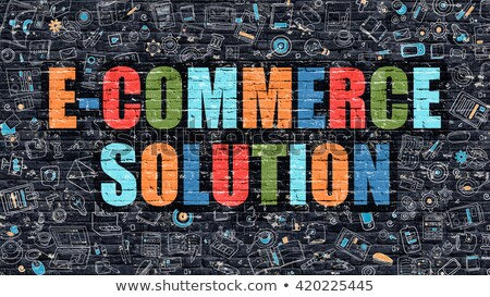 E-Commerce Solution Concept. Multicolor on Dark Brickwall. Stock photo © tashatuvango