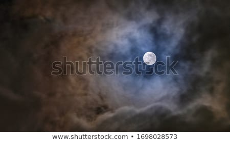 Moon behind cloud at blue sky Stock photo © Juhku