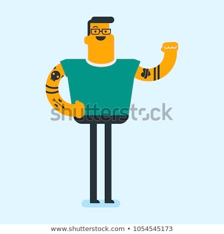 caucasian white man with a tattoo showing biceps stock photo © rastudio