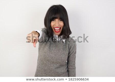 Zangado gritando jovem caucasiano senhora em pé Foto stock © deandrobot
