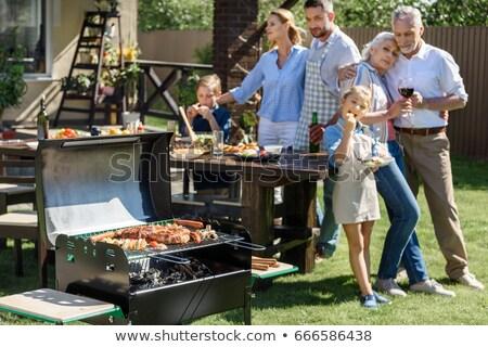 Família almoço jardim diversão retrato refeição Foto stock © IS2