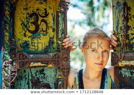 Young girl half in half out of doorway. Stock photo © IS2