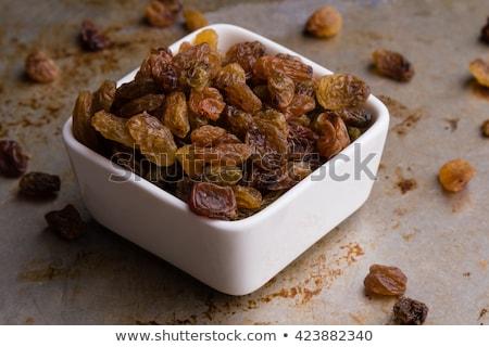 tál · édes · mazsola · fából · készült · vágódeszka · étel - stock fotó © digifoodstock