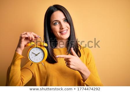 Stockfoto: Vrouw · klok · tijd · shirt · studio