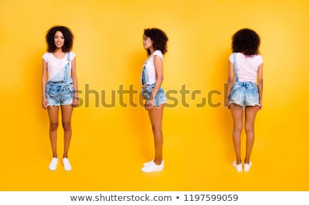 Stylish composition of beautiful female legs in jeans, black high heeled shoes and a pink rose adorn Stock photo © artjazz