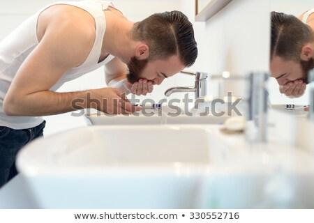 Maschio mano spazzolino acqua bagno mani Foto d'archivio © diego_cervo